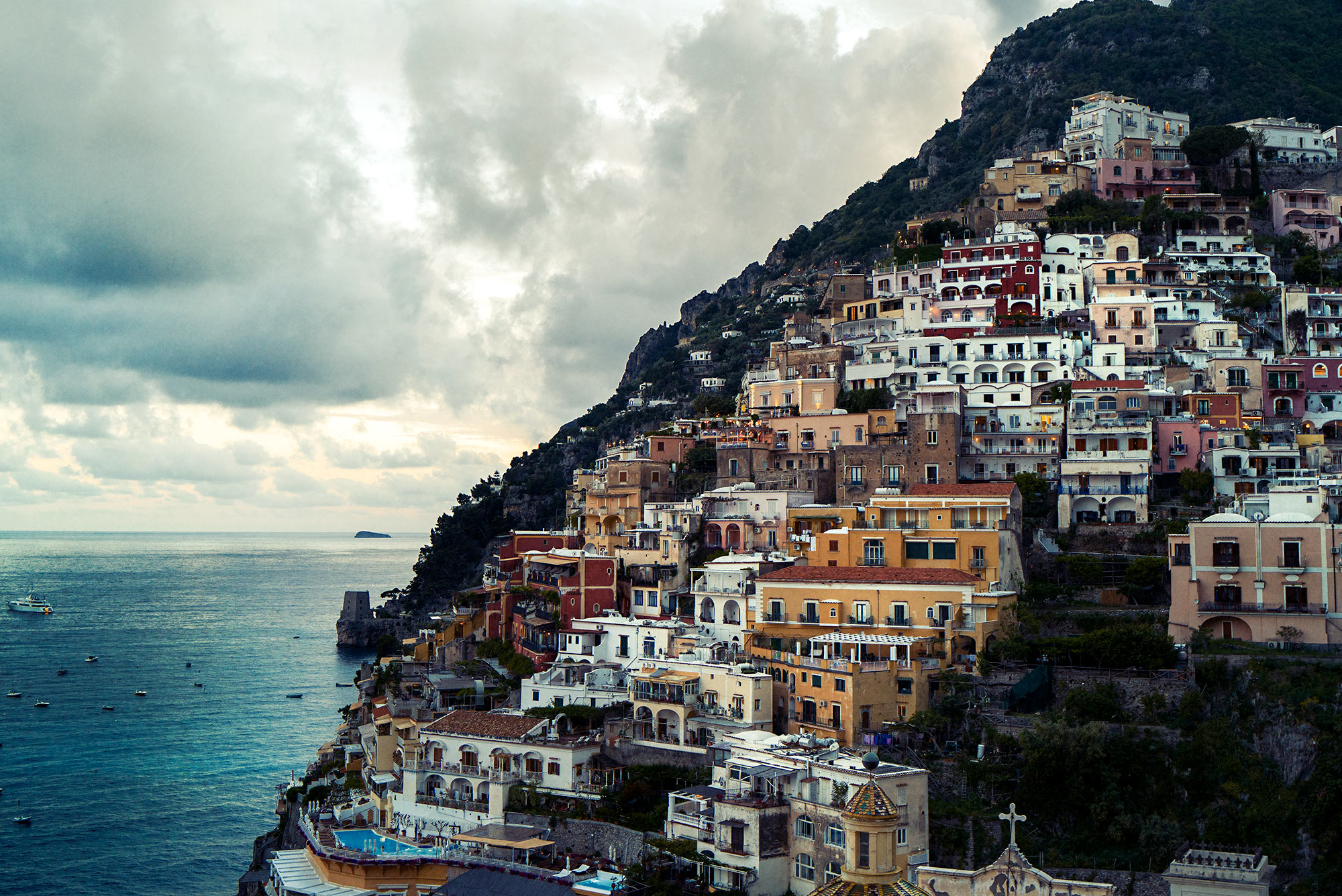 Good Boy Wolf Photographer, filmic landscape, Positano Italy, buildings on cliff edges looking out to sea