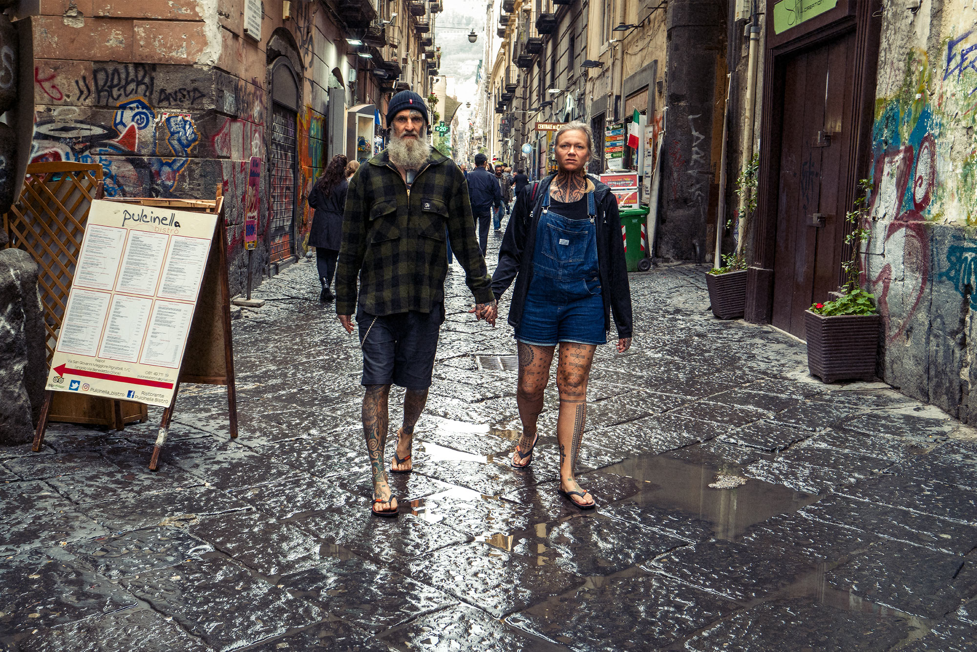 Good Boy Wolf Photographer, filmic portrait tattooed couple walking on cobbles