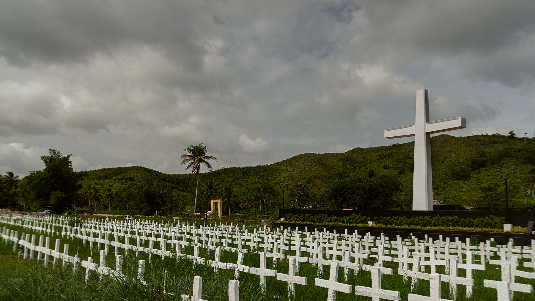 Good Boy Wolf Photographer, filmic landscape, Philippines, large white cross in a cemetery