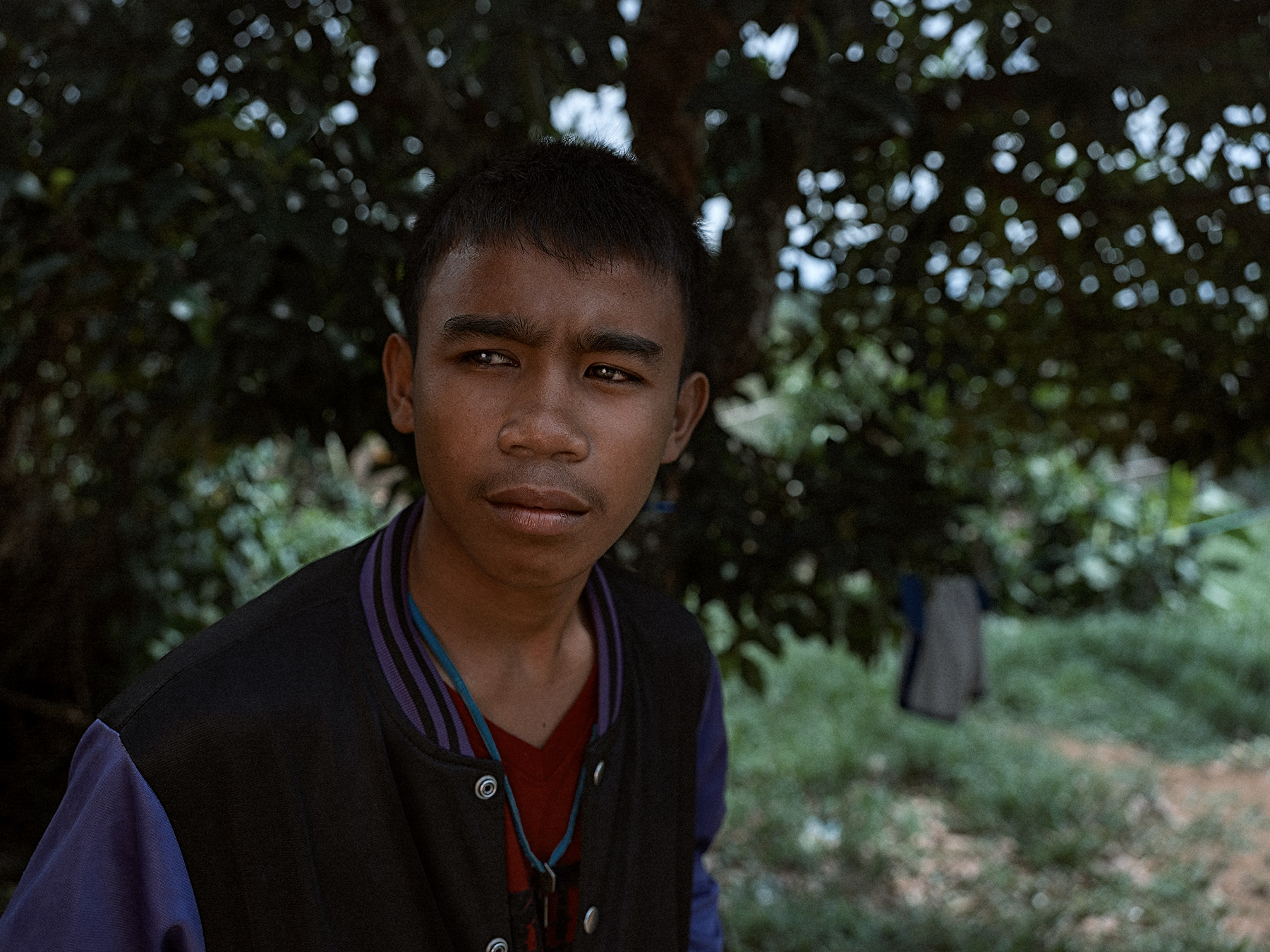 Good Boy Wolf Photographer, Philippines, teenager stares camera, purple black jacket