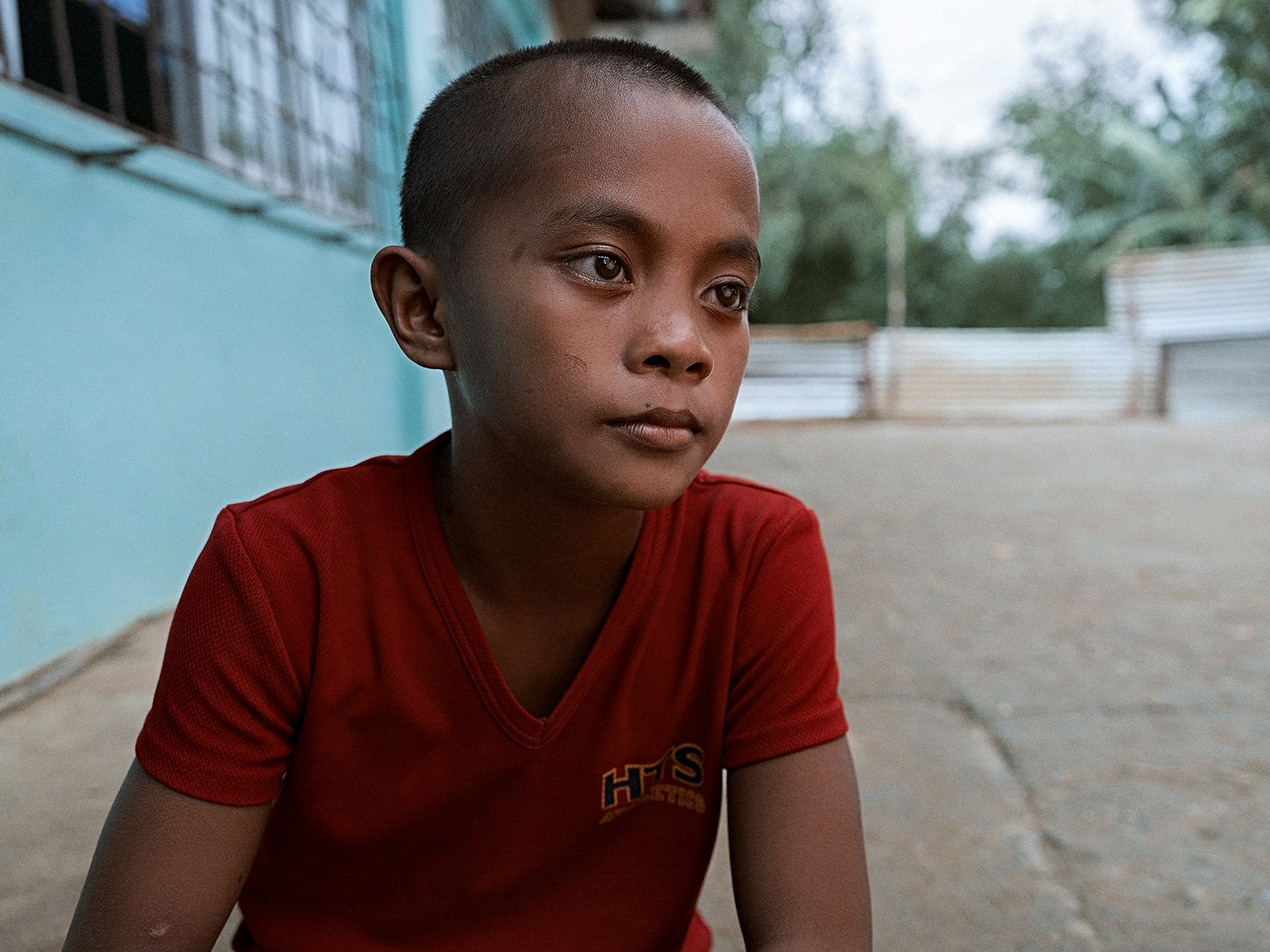 Good Boy Wolf Photographer, Philippines, young boy looking sad wearing a red t shirt