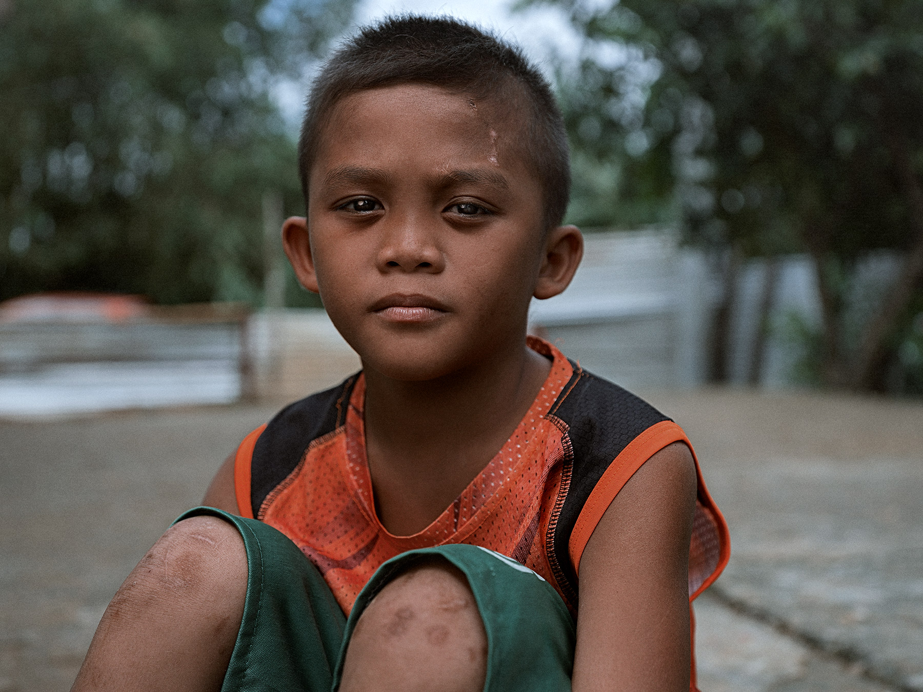 Good Boy Wolf Photographer, Philippines, young boy sitting on the floor hugging legs