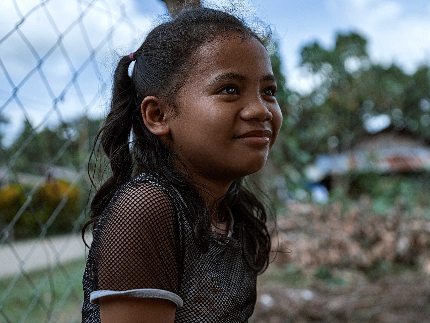 Good Boy Wolf Photographer, Philippines, young girl wearing a black top smiling