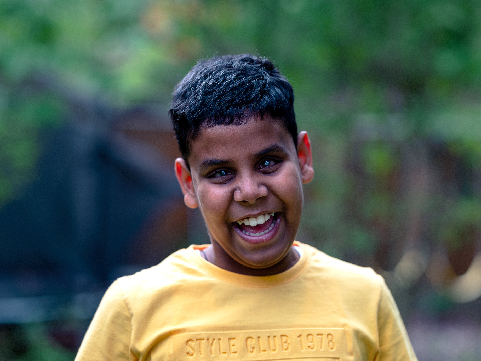 Laughing young boy, Good Boy Wolf Photographer, filmic portrait