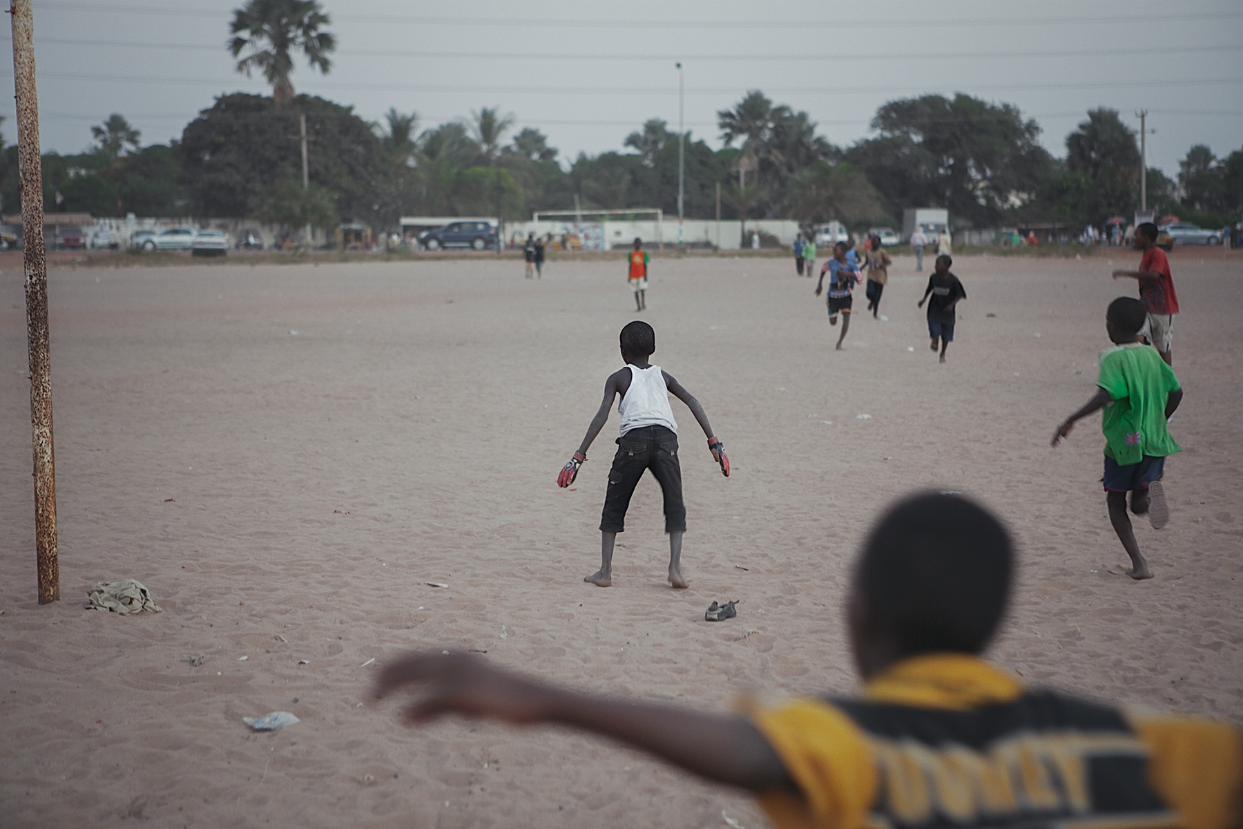 Good Boy Wolf Photographer, Gambia, west Africa, young boys running with a football