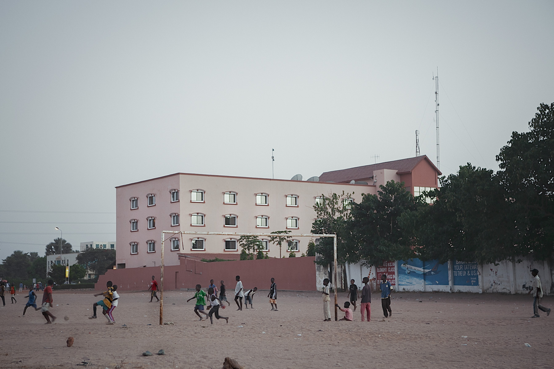 Good Boy Wolf Photographer, Gambia, west Africa, young footballers playing on dusty floor