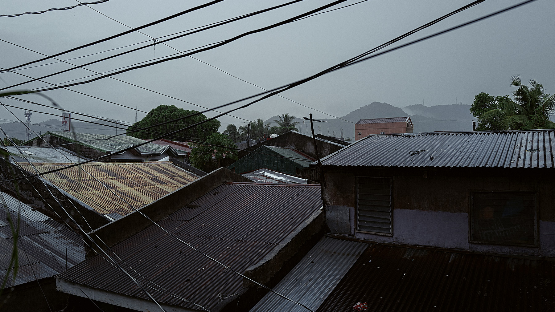 Good Boy Wolf Photographer, filmic landscape, Philippines, roof tops lots of colours