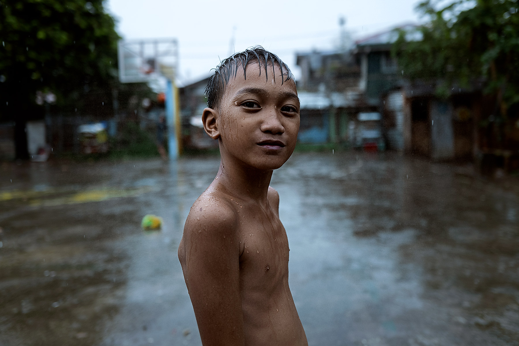 Good Boy Wolf Photographer, Philippines, Basket ball child, stood outside in the rain