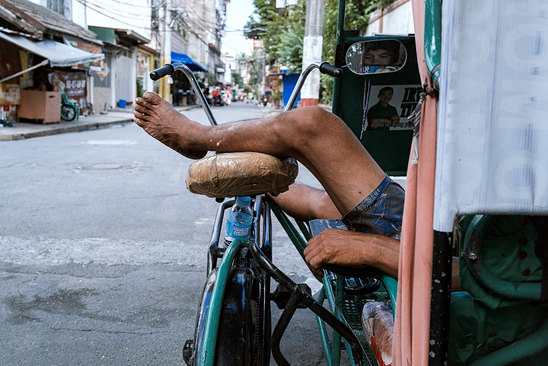 Good Boy Wolf Photographer, Philippines  relaxing taxi driver with his legs up