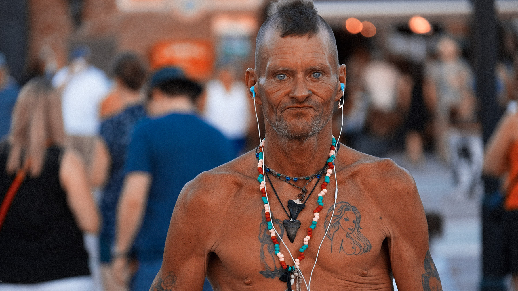 Good Boy Wolf Photographer, filmic portrait, topless tattooed man in the street