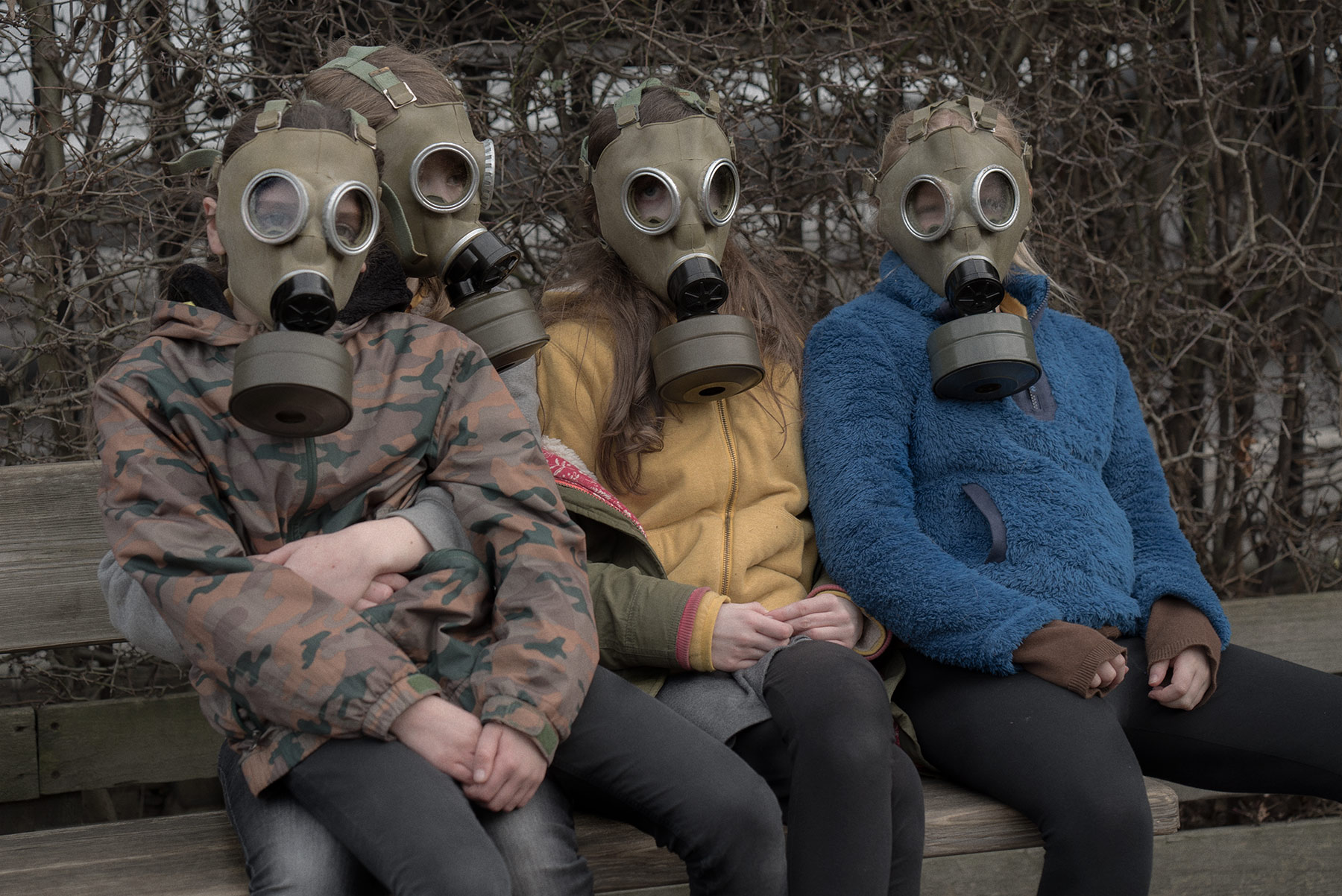 Good Boy Wolf Photographer, filmic portrait, children wearing gas masks outside