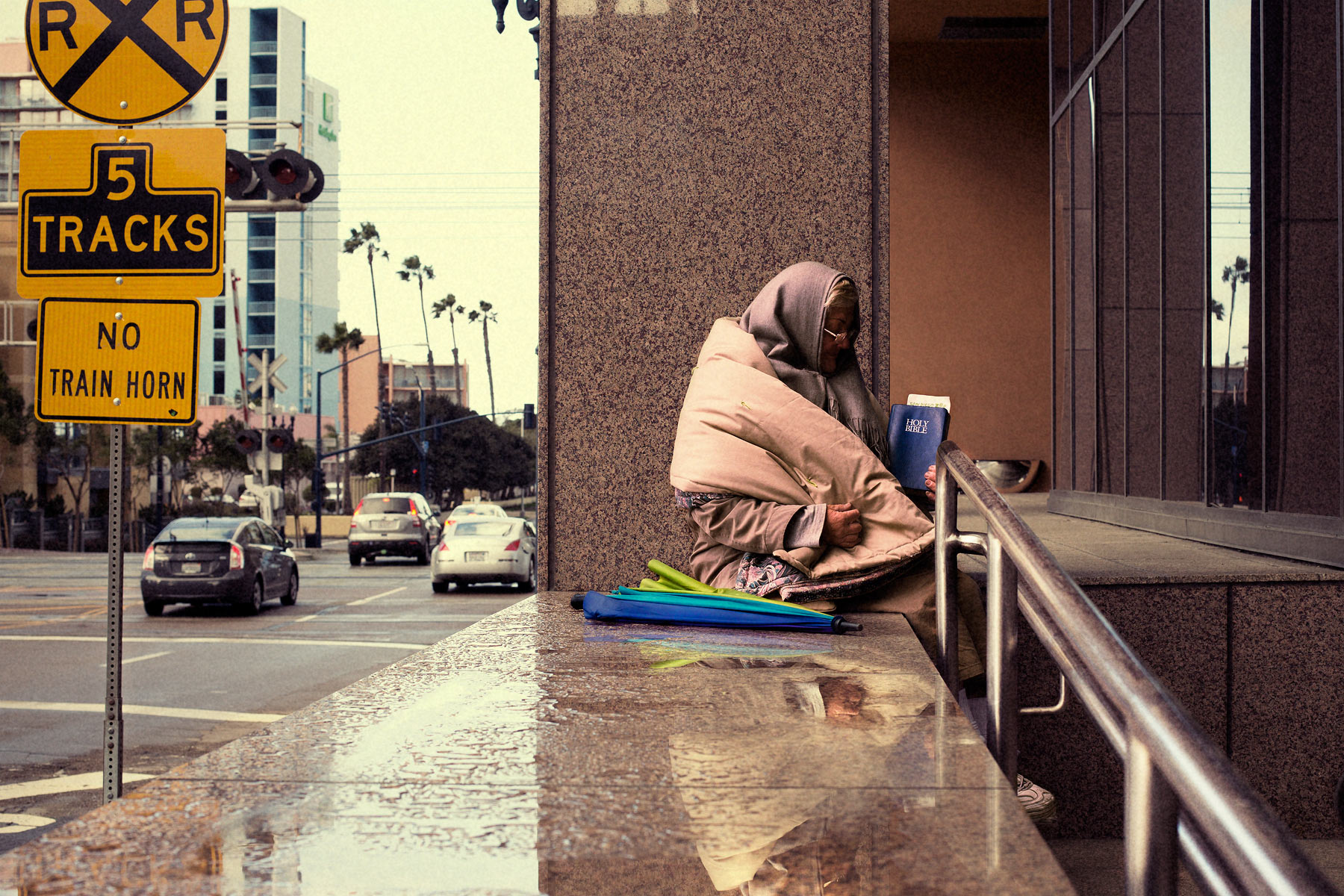 Good Boy Wolf Photographer, filmic portrait, homeless woman reading her bible