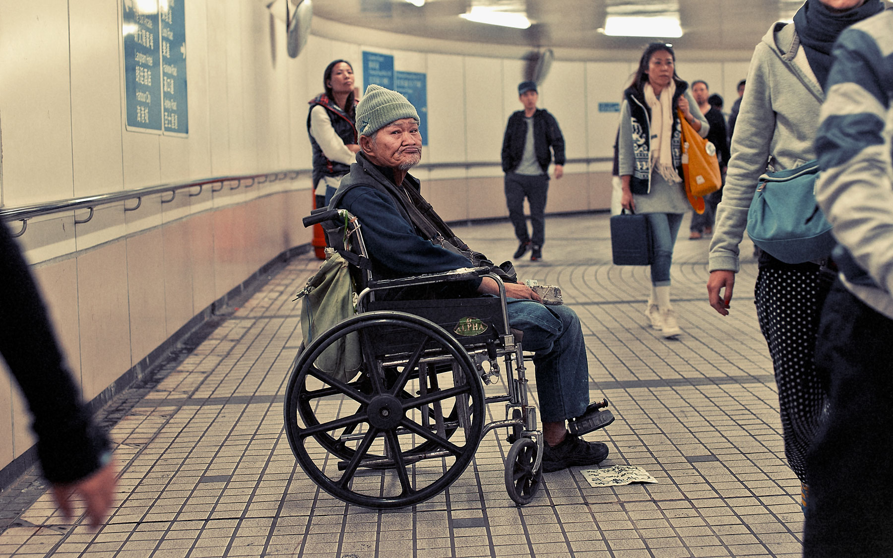 Good Boy Wolf Photographer, filmic portrait, man in a wheel chair in a subway tunnel