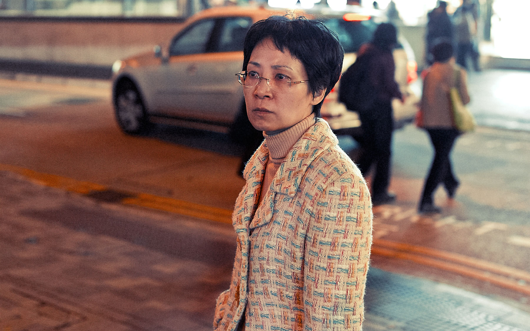 Good Boy Wolf Photographer, filmic portrait, Chinese woman walking down the street,