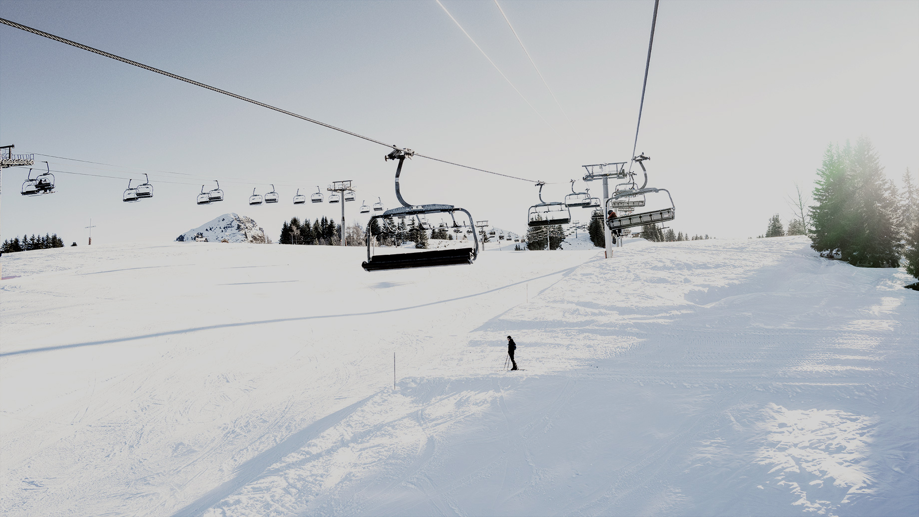 Good Boy Wolf Photographer, filmic portrait, lesgets sky resort, gondolas moving in the sky
