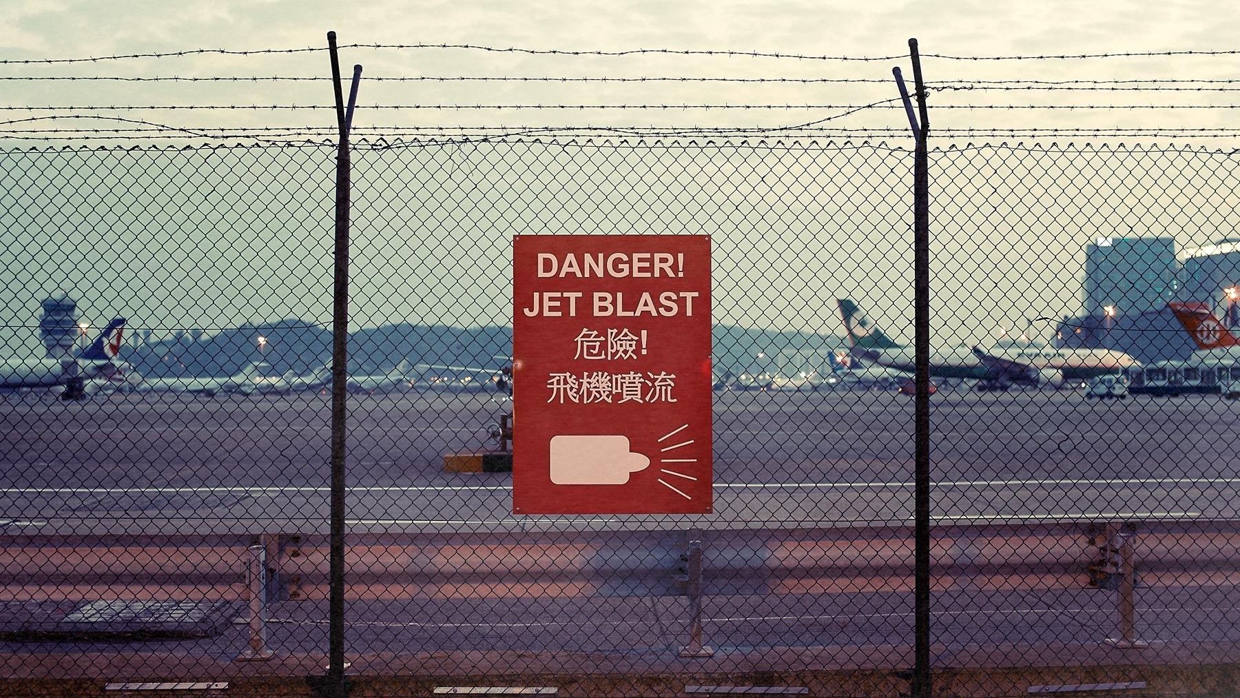 Good Boy Wolf Photographer, filmic landscape,  warning sign at Macau airport