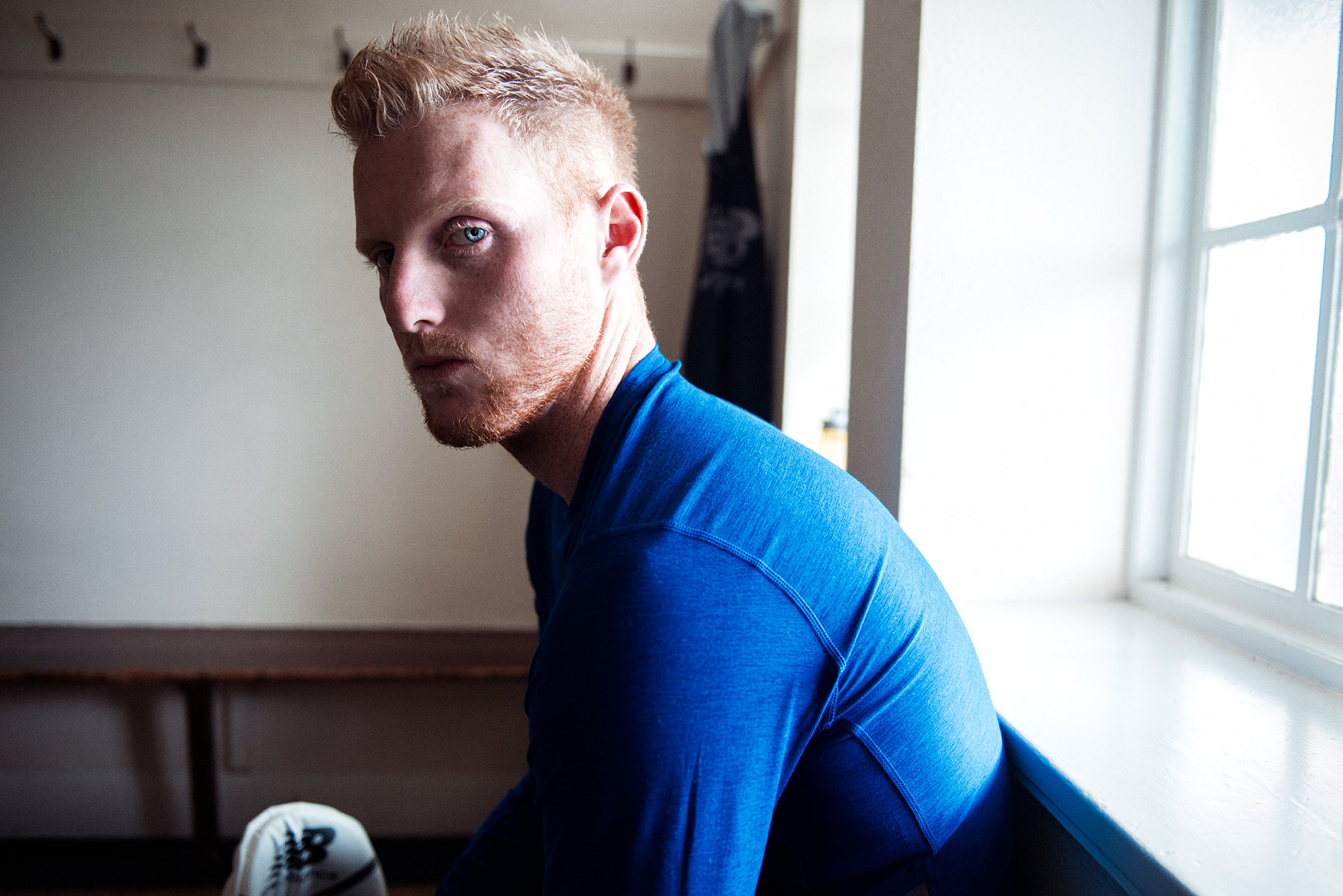 Good Boy Wolf Photographer, filmic portrait, ben stokes England cricketer sitting in a changing room