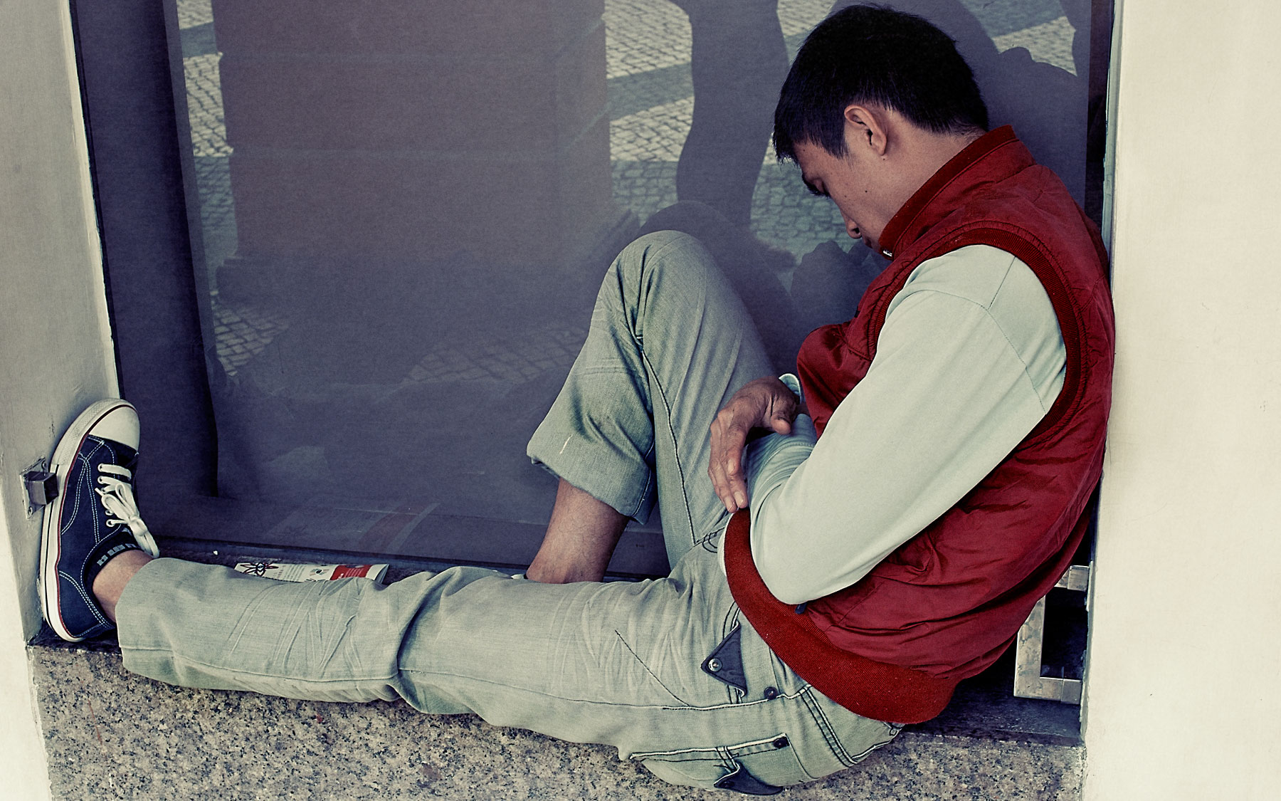 Good Boy Wolf Photographer, filmic portrait, Chinese teenager asleep on a small wall