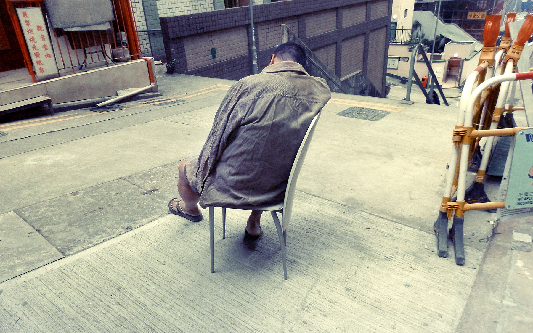 Good Boy Wolf Photographer, filmic portrait, Chinese man sleeping on a chair