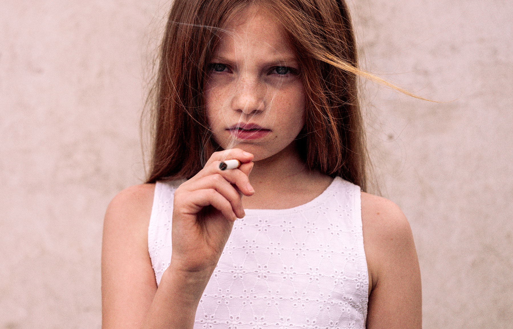 Good Boy Wolf Photographer, young girl wearing a white dress smoking a cigarette
