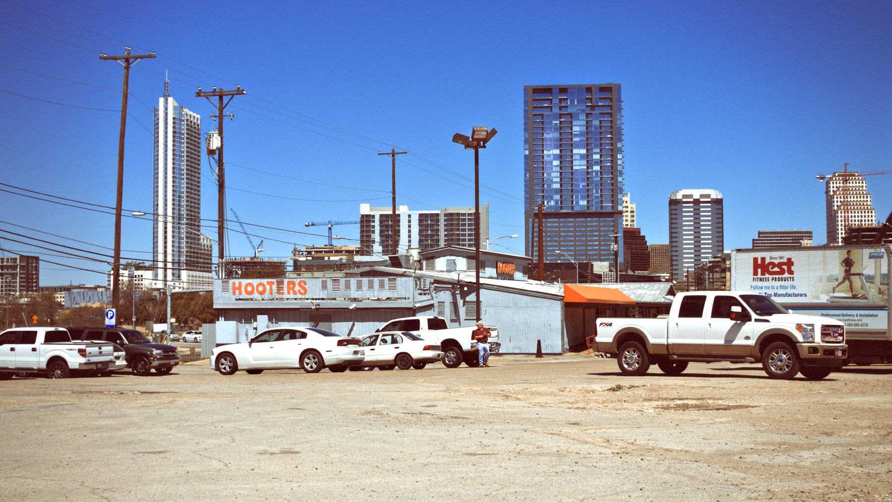 Good Boy Wolf Photographer, filmic landscape, Austin Texas, carpark filled with trucks